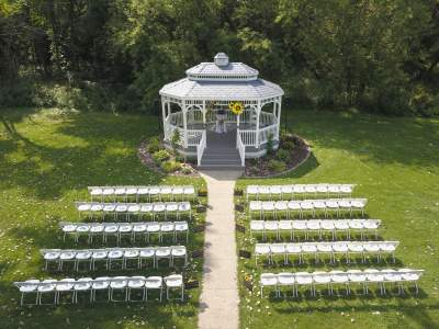 Outdoor wedding ceremony gazebo set up for 90 wedding guests